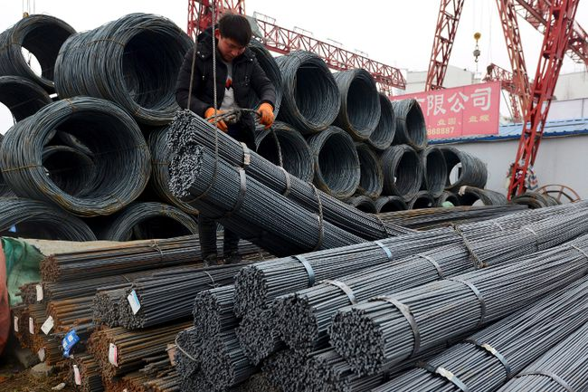 A worker loads steel products onto a vehicle at a steel market in Fuyang in central China's Anhui province Friday, March 2, 2018. The government is taking further steps to crack down on companies that try to ship cheap foreign steel and aluminum through the Canadian market. THE CANADIAN PRESS/Chinatopix Via AP