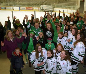 The Lucan community joined together at the Lucan Community Memorial Centre on March 17 to hear the news about the town cracking Kraft Hockeyville's top four. Pictured are members of the Lucan community with Mayor Cathy Burghardt-Jesson and some of the Lucan Irish Bantam C team cheering the news by the Lucan ice. (William Proulx/Exeter Lakeshore Times-Advance)