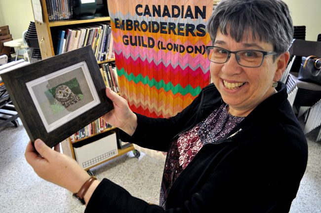 Pat Ferries, president of Canadian Embroiderers' Guild London, holds artwork by Joy Lajoie-Cowell. The guild's annual Textile Showcase is April 20-21. (CHRIS MONTANINI\LONDONER)