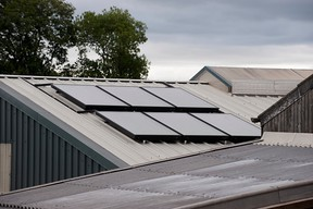 Solar panels on dairy roof which supply hot water to clean milking parlour. (Getty Images)