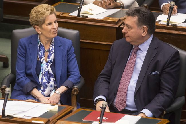 Ontario Premier Kathleen Wynne and Provincial Finance Minister Charles Sousa attend the Throne Speech at the Ontario Legislature in Toronto on Monday, March 19, 2018. THE CANADIAN PRESS/Chris Young