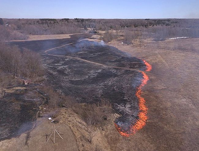 Drone footage of the grass fire at Saugeen First Nation shows a line of fire on the landscape as the first crept across the field on March 25, 2018. The blaze took over five hours for Saugeen First Nation firefighters to extinguish, but no structural or property damage was reported. (Shared photos by Larry Leonard)