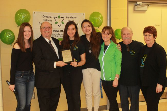 MPP Bob Bailey (second from left) and his granddaughter/translator Janessa Lavadie (far left) were at the Sarnia-Lambton French Community Centre on March 23 to present a plaque and cheque for $74,000 from the Ontario Trillium Foundation to the centre's president Tanya Tamilio (third from right). The money was given to the centre to promote health and physical fitness for Lambton County francophone youth.From left to right: Janessa Lavadie, Bob Bailey, Tiana Cooke,  Anna Luisa Cortez, Tanya Tamilio, Gus Croteau, Diane Lamarche.