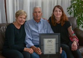 Milt Brandson poses with his wife Maureen and daughter Melanie Todd after celebrating 40 years of working as a realtor with Century 21.