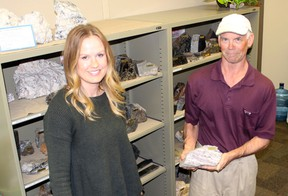 Kenora district geologists Greg Ravanaas and Kristen Wiebe will attend the Ontario Prospectors Exploration Showcase in Thunder Bay, April 3 - 5. Ravanaas is pictured with a sample of lithium bearing lepidolite rock from Avalon Advanced Materials' Big Whopper deposit at the company's Separation Rapids project north of Kenora. Reg Clayton/Miner and News
