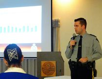 Staff Sgt. Jeremie Landry speaks at the policing open house last Friday.