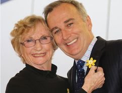 TIM MEEKS/THE INTELLIGENCER Karen White, volunteer president at the Canadian Cancer Society's Hastings-Prince Edward and Brighton chapter, pins a daffodil to Bay of Quinte MP Neil Ellis' lapel during the official launch of Daffodil Month fundraiser Wednesday at Loyalist College.