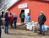 Mary Beth (second from the right) and Bob Gray (right), maple syrup producers from Kemble, sold their product at the 2018 Purple Valley Maple Syrup Festival near Wiarton, March 31. Photo by Zoe Kessler/Wiarton Echo