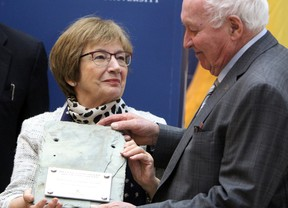 Helene Cote Sharp and Dennis Sharp receive a gift of gratitude for their $5-million donation to the future Cote Sharp Student Wellness Centre at Queen's University in Kingston, Ont. on Thursday April 5, 2018. Steph Crosier/The Whig-Standard/Postmedia Network
