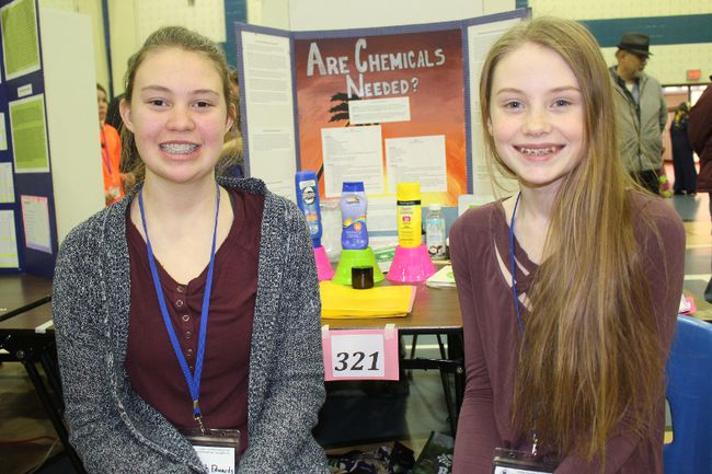Elizabeth Edwards (left) and Grace Eamer, Grade 8 students at Char-Lan District High School, and participants in the 43rd annual United Counties Science Fair. Photo on Saturday, April 7, 2018, in Cornwall, Ont. Todd Hambleton/Cornwall Standard-Freeholder/Postmedia Network