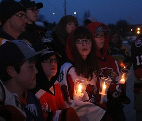 Krys Rodmell and her children Dylan, Madison and Cam, were among more than 200 people at Memorial Gardens Sunday night to pay tribute to the 15 people who were killed Friday when a bus carrying the Humboldt Broncos collided with a transport. Fourteen others on the bus suffered injuries in the crash. PJ Wilson/The Nugget