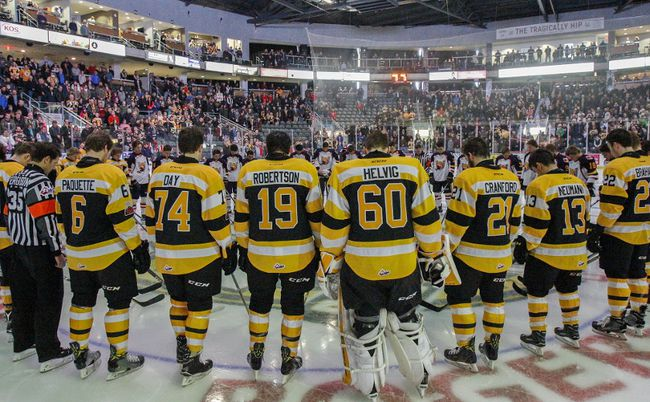 JULIA MCKAY/The Whig-Standard Kingston Frontenacs and Barrie Colts players, along with the on-ice officials, encircle centre ice with their heads bowed for a moment of silence in honour of the players, families and staff of the Humboldt Broncos junior hockey team, before the Ontario Hockey League Eastern Conference semifinal game at the Rogers K-Rock Centre on Sunday night. A fatal bus crash in Saskatchewan on Friday night left 15 of the 29 passengers on the Broncos' team bus dead, and the other 14 injured.