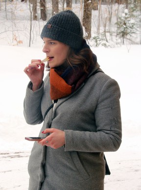 Rachel Macintyre enjoys a bit of maple taffy, Saturday, at Bella Hill Maple in Powassan. Local maple syrup operators were open to the public as part of Maple Weekend, although Friday night's snowfall and cold temperatures have interfered with the operations recently.PJ Wilson/The Nugget