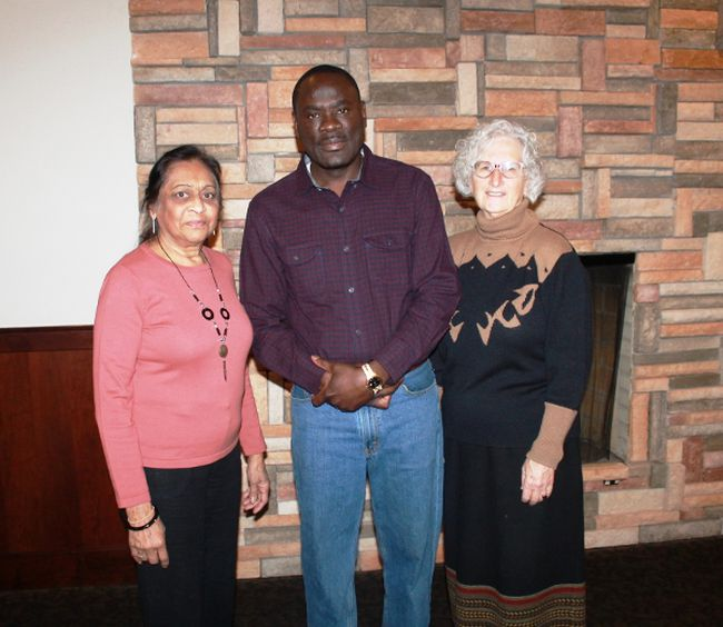 Lambton College nursing graduate Christopher Omira (centre) spoke about his life and his efforts to improve the lives of people in his western Kenyan hometown, during a presentation to the Rotary Club of Sarnia Bluewaterland on March 28.
