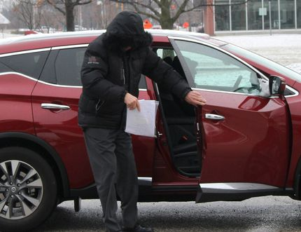 Claude Eric Trachy kept his face hidden from view when arriving at the Chatham Court House in Chatham, Ont. on Friday April 6, 2018 for his trial. The 72-year-old is facing several historic sex-related charges involving 25 female complainants. Ellwood Shreve/Chatham Daily News/Postmedia Network