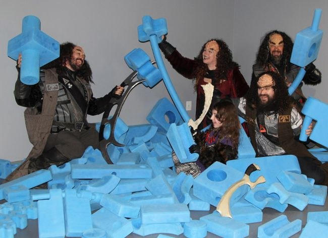 Members of Crimson Dawn, the Timmins chapter of the Klingon Assault Group, frolic amongst the large-sized blocks at Science Timmins during a reception held there following a flag raising to mark Klingon Empire Day in March 2017. From left, Peter Hutchison, Karen Hutchison, Aelan Hutchison, Pierre Ouellette, and Thomas Hutchison. Members of Crimson Dawn plan to drop in at Science Timmins on the Sunday of their Klingon Rumpus weekend, April 21-22.