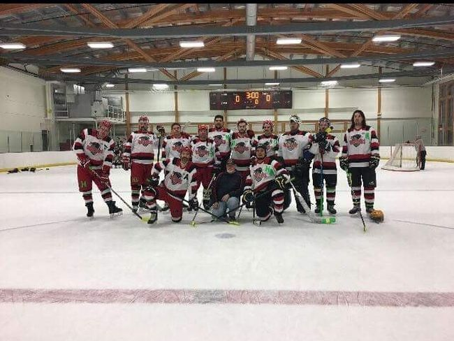 The North East Warriors recreational hockey team poses with their crests honouring the Humboldt Broncos following the Banff Cup last weekend.