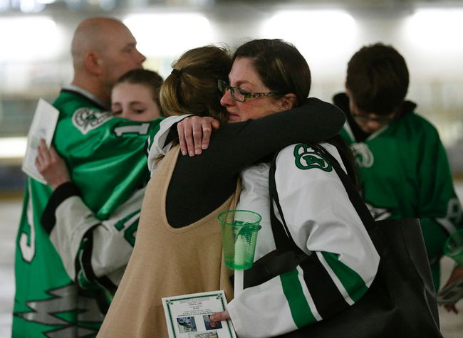 Cory Anne Holmlund (front right) is hugged during a vigil held for former Drayton Valley Thunder hockey player Parker Tobin at the Omniplex in Drayton Valley, Alberta on Tuesday. She was Parker Tobin's billet mother. The hockey player for the SJHL Humboldt Broncos team was one of the players who died in a fatal bus crash when the team bus collided with a semi-trailer on a Saskatchewan highway. Parker Tobin was mistakenly believed to have survived the crash but it was later learned that he had been misidentified with teammate Xavier Labelle, who did survive. Larry Wong/Postmedia Network