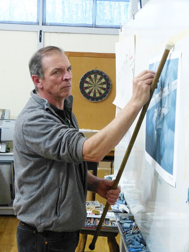 Brian Hohner in his studio demonstrating how he did the Canso painting