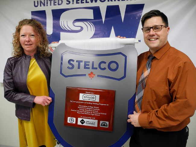 Students at Assumption College in Brantford made this plaque to thank Stelco in Nanticoke for donating $182,000 to upgrade welding education programs at local Catholic and public high schools. Among those in the Nanticoke Industrial Park Wednesday for the unveiling were Allison Hayes, principal of Assumption College, and Rob Malcolm, principal at Waterford District High School. MONTE SONNENBERG / SIMCOE REFORMER