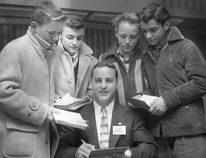 The first Sports Celebrity Dinner at Hotel London, March 7, 1957, shown is Pat O'Connor signing autographs.