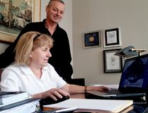 Isaac Brock Bed and Breakfast owners Ida and David Duc sit at their booking space on Wednesday. (RONALD ZAJAC/The Recorder and Times)