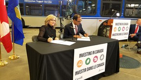 Alberta Infrastructure Minister Sandra Jansen (left) and federal Minister of Infrastructure and Communities Amarjeet Sohi sign the Investing in Canada Infrastructure Plan as a bilateral agreement between the two levels of government, resulting in a $15-million funding announcement for Strathcona County.  Photo Supplied