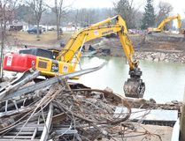 Excavators at the site of the Port Bruce bridge which collapsed amidst heavy rainfall and melting Feb. 23. (Louis Pin/Times-Journal)