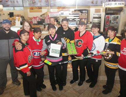 KEVIN RUSHWORTH HIGH RIVER TIMES/POSTMEDIA NETWORK. High River Tim Hortons staff have raised, to date, $1,070 in donations through sales of the Humboldt Broncos Strong doughnut. One hundred per cent of the proceeds go toward the Humboldt Broncos Hockey Club. These special doughnuts are $1 plus tax. Sales will continue at the local restaurant for an undetermined period. All donations are accepted. As pictured, Tim Hortons High River staff, wearing their jerseys and with their hockey stick, show off the doughnuts along with Calgary resident David Reid who donated $20 to the cause.