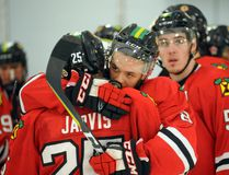 Brockville Braves Zac McMahon hugs Andrew Jarvis after his team lost 5-1 against the Ottawa Jr. Senators in Game 7 on Wednesday at the Memorial Centre. After wearing the Braves jersey for 259 regular season and playoff games over the course of five years, Wednesday marked Jarvis' last game wearing Brockville colours. (Photo by Phil Kall)