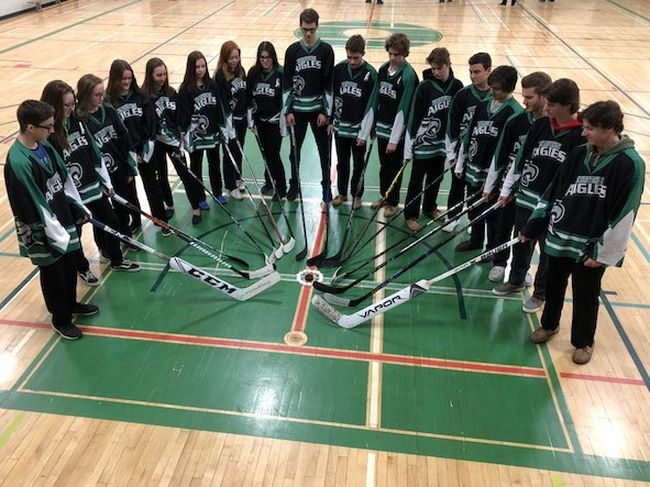 Staff and students from Ecole secondaire catholique l'Horizon, as well as many other local schools, rallied behind the Humbolt Broncos on Thursday, wearing jerseys or green-and-yellow shirts to school. Many schools also placed hockey sticks outside their school in solidarity with all those who were affected by the tragedy in Saskatchewan. Photo supplied