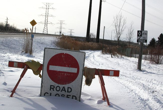 Signs, pictured late last year, deter travellers from using a path northwest of the Sun curve bridge. The City of Sarnia is appealing to the Canadian Transportation Agency to mediate stalled negotiations to create a safe crossing over CSX rail lines. (Observer file photo)