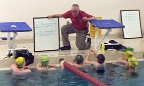 Chatham Y Pool Sharks head coach Brian Lindsay will be in Victoria B.C. for the next week working with Canadian Olympic open water coach Ron Jacks, of UVic Pacific Coast Swimming, through a program by the Canadian Swim Coaches Association. Lindsay is pictured here Friday, April 13, 2018 working with some Y Pool Sharks. (Handout)