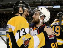 Kingston Frontenacs' Gabe Vilardi, left, and Barrie Colts' Aaron Luchuk, embrace after the Frontenacs defeated the Colts 2-1 to win the Eastern Conference semifinal series 4-2 at the Rogers K-Rock Centre in Kingston on Friday. Both players are from Kingston and it was Luchuk's last junior game. (Ian MacAlpine/The Whig-Standard)
