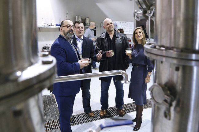 Minister of Energy and Sudbury MPP Glenn Thibeault, left, announced funding through the Northern Ontario Heritage Fund Corporation for three new Sudbury and area businesses at Crosscut Distillery in Sudbury on Friday. Shane Prodan, second left, of Crosscut Distillery, Kerry LeBreton, of Good4Ushrimp, and Chantelle Smith, of BE Greater Organics, all received funding for their new businesses. John Lappa/Sudbury Star/Postmedia Network