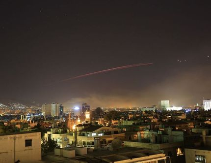 Damascus skies erupt with anti-aircraft fire as the U.S. launches an attack on Syria targeting different parts of the Syrian capital early Saturday. Hassan Ammar / AP