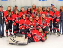 In front is Agathe Fontaine, Kneeling, from left, are senior players Elisabelle Bourget, Bailey Fraser, Marie-Eve Ethier and Angelique Fontaine. At back are Jim McCormick (head coach), Kaitlyn Seyeau, Mariah Bougie, Jeff Ostler (assistant coach), Danika Poulin, Madison Bellmore, Taylor McElligott, Madison McCormick, Tayiah Oakes, Alison Wert, Al McElligott (assistant coach), Elizabeth Bourdeau and Abi Fontaine (trainer). Handout/Cornwall Standard-Freeholder