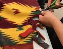 A member of the Tyendinaga Mohawk Territory cancer talking circle works on a healing blanket. (Supplied Photo)