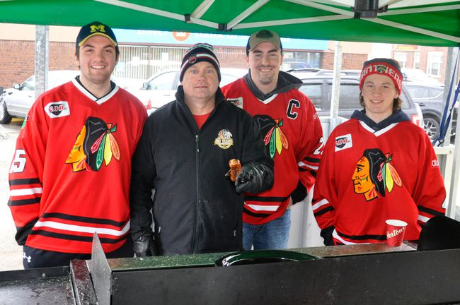 Nick Jung (left), Mark Crawford (team president), Mackinnon Hawkins and Reid Ramseyer of the Mitchell Jr. C Hawks held a fundraiser at Walkom's valu-mart last Saturday, April 14 for those affected by the tragic Humboldt Broncos bus crash April 6. ANDY BADER/MITCHELL ADVOCATE
