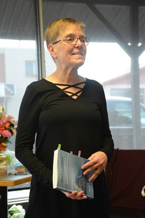 Bonnie Ryan-Fisher reads passages from her new book, Mindful Moments, at the Orchard Café on April 14 (Peter Shokeir | Whitecourt Star).