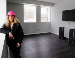 Luke Hendry/The Intelligencer Developer Alexis Kofman stands in a larger unit of the future Belleville Estates Retirement Community Monday. The building at 228 Dundas St. E. is undergoing a major renovation and could reopen in August.