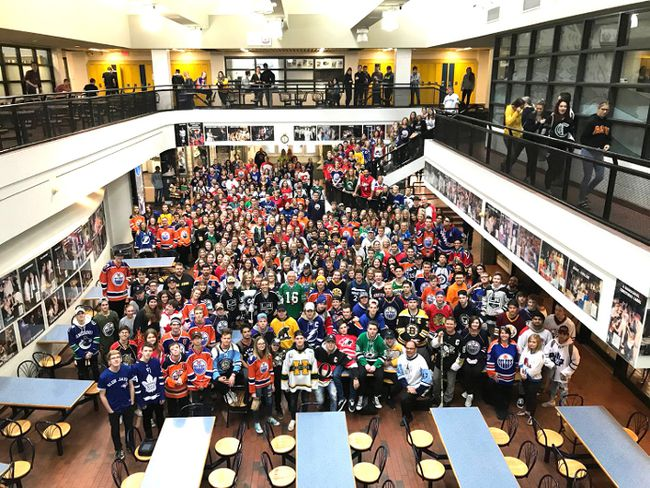 Students at Bev Facey Community High School gather in their jerseys as a show of support for the Humboldt Broncos, following the recent tragedy of 16 players and staff members killed in a bus crash.