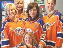 Soo Thunderbird hockey moms, clockwise, from front, are Lorie Bellini, Paula Theriault, Raea Caruso, Patti Smith and Carol Ford.