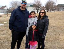 Matt and Amelia Thurston with daughters Aaliyah, 11, and Hailey, 5, at the site of their new home in north central Kenora residential neighbourhood. The build is the third project for Kenora Habitat for Humanity. Reg Clayton/Daily Miner and News