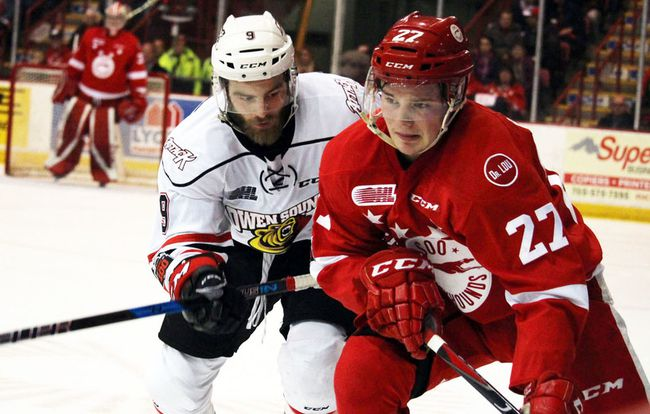 Owen Sound Attack centre Ethan Szypula (left) tails Sault Ste. Marie Greyhounds centre Barrett Hayton during first-period OHL playoff action in April at Essar Centre. JEFFREY OUGLER/SAULT STAR/POSTMEDIA NETWORK