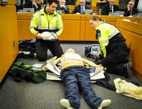 Huron County Council watch while Huron County Paramedics, Adam Robinson and Cassie Crawford, give a demonstration of the Zoll MedicalAutoPulse Resuscitation System. (Jenna Ujiye)