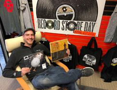 Mark Alles, the manager of The Record Works, shows off a couple of the limited-edition records that will be available Saturday during Record Store Day (BRUCE URQUHART/SENTINEL-REVIEW)