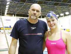 Coach Dean Henze with swimmer Nina Kucheran at Sudbury Laurentian Swim Club practice on Tuesday. Gino Donato/Sudbury Star
