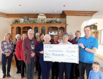 Michelle Field (far left), Jay McFarlan (far right) and the ladies of the IODE Maple Leaf Chapter with the $10,000 donation. Currently, it is undecided what the donation will fund at the hospice, but the ladies of the IODE were considering their options such as anything related to home décor or furnishing, which also included purchasing a specialized bed (cost upwards of $10,000); where the money will help is to be decided. (Kathleen Smith/Goderich Signal Star)
