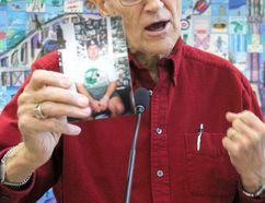 Heart transplant recipient Harold Brain holds a photo of Laine, who died while waiting for an organ transplant, during a BeADonor event at Civic Centre on Thursday.
